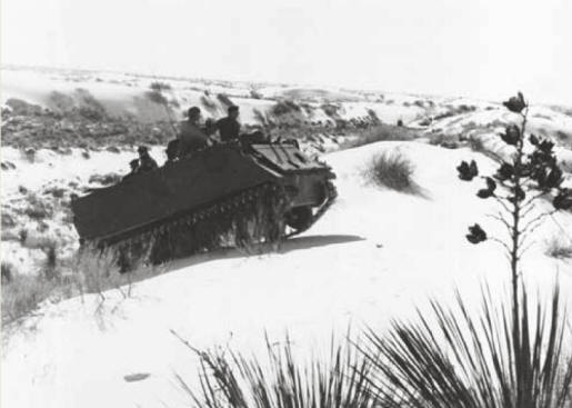 Military: Driving a tank at White Sands National Monument, New Mexico